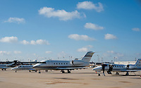 Private and corporate jets line the runway at Dallas International Airport in Dallas, Texas, Monday, February 7, 2011. After a difficult slump, private jet travel is making a modest comeback. ..Matt Nager for The Wall Street Journal