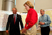 Washington, D.C. - September 4, 2005 -- United States President George W. Bush visits the American Red Cross Command Center in Washington, D.C., September 4, 2005. At right are Red Cross President and CEO Marty Evans (red shirt) and Executive Vice President, Chapter and International Operations, Alan McCurry.<br /> Credit: Martin H. Simon - Pool via CNP