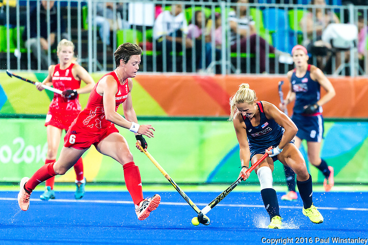 Kelsey Kolojejchick #7 of United States protects the ball against Hannah Macleod #6 of Great Britain during Great Britain vs USA in a women's Pool B game at the Rio 2016 Olympics at the Olympic Hockey Centre in Rio de Janeiro, Brazil.