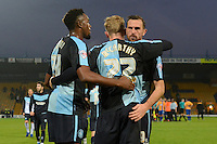 Wycombe Wanderers Gozie Ugwu, Jason McCarthy and Paul Hayes celebrate following the Sky Bet League 2 match between Mansfield Town and Wycombe Wanderers at the One Call Stadium, Mansfield, England on 31 October 2015. Photo by Garry Griffiths.