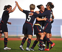 Lauren Cheney (middle, to right of player #5) celebrates her game winning goal vs Iceland in the 2010 Algarve Cup in Portugal. Game was played in Vlia Real Sto. Antonio. Left to right:  #9 Heather O'Reilly, #5 Lori Lindsey, #11 Lauren Cheney, #10 Carli Lloyd and behind Lloyd, #20 Abby Wambach.