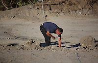 Pictured: A forensic archaeologist works at the second site in Kos, Greece. Saturday 15 October 2016<br />