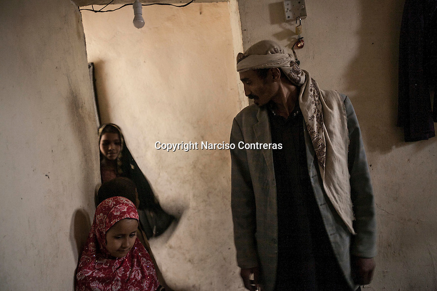 Wednesday 15 July, 2015: Tawfiq Hussain Djaber (front) stands with his family inside a roomhouse in an abandoned salafist madrasa (university) where 7000 students used to live and learn in Dammaj village. The madrasa is now used as temporary shelter for the displaced families from the heavy fighting and bombarments in Sa'dah governorate in the northern province of Sa'dah, the stronghold of the Houthi's movement in Yemen. (Photo/Narciso Contreras)