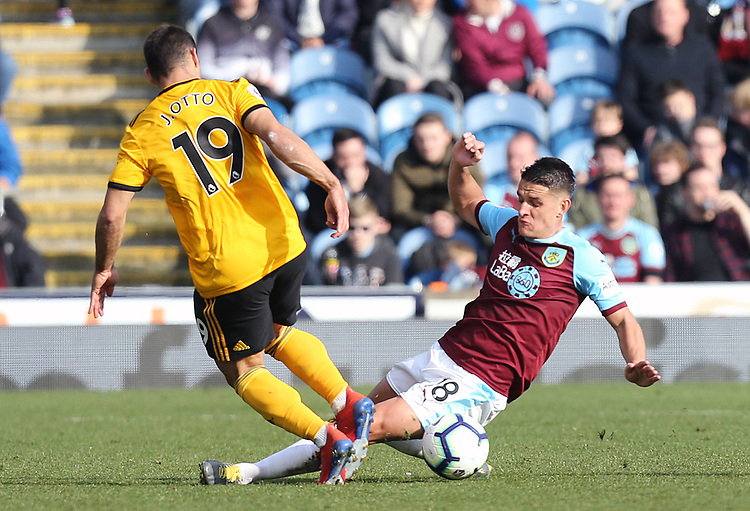Burnley's Ashley Westwood vies for possession with Wolverhampton Wanderers' Jonny<br /> <br /> Photographer Rich Linley/CameraSport<br /> <br /> The Premier League - Burnley v Wolverhampton Wanderers - Saturday 30th March 2019 - Turf Moor - Burnley<br /> <br /> World Copyright © 2019 CameraSport. All rights reserved. 43 Linden Ave. Countesthorpe. Leicester. England. LE8 5PG - Tel: +44 (0) 116 277 4147 - admin@camerasport.com - www.camerasport.com