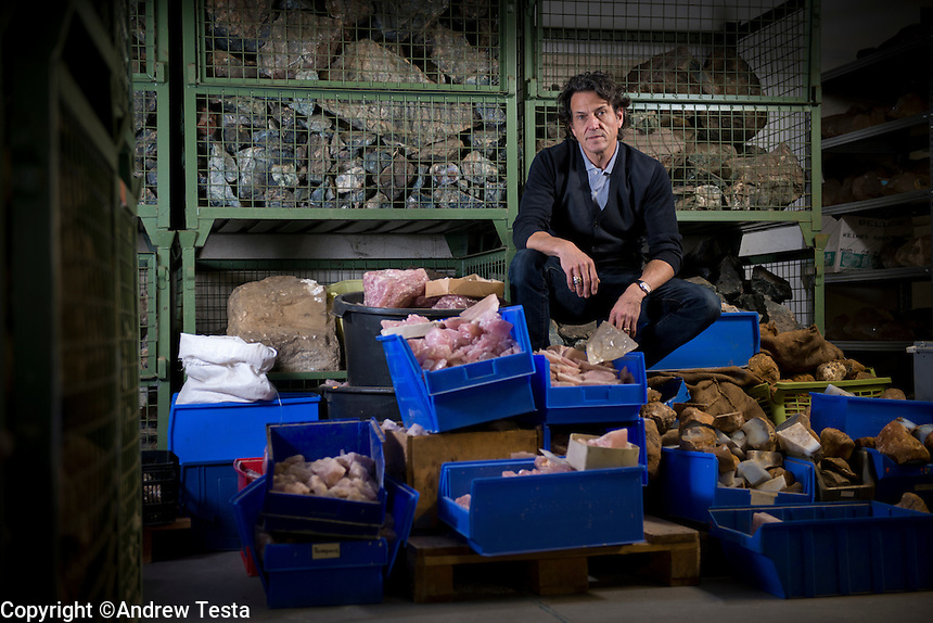 Germany. . 21st October 2013<br /> Stephen Webster photographed in the basement of Groh and Ripp, where all uncut stones and rocks are stored.<br /> &copy;Andrew Testa/Panos for the Sunday Times Magazine