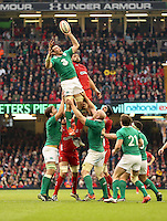 Pictured: An Ireland player almost loses the ball from a line out to Taulupe Faletau of Wales Saturday 14 March 2015<br />