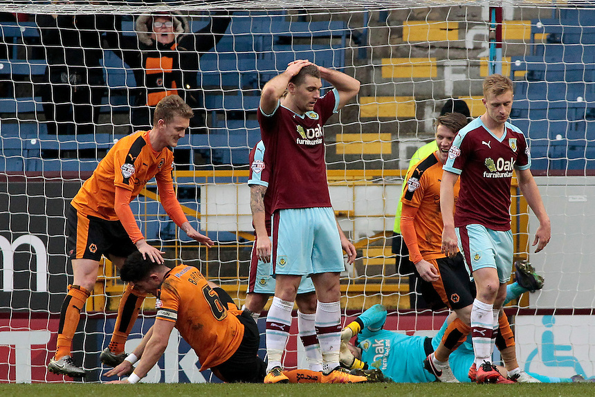 Burnley players show their dejection after Wolverhampton Wanderers' Danny Batth makes it 1-1<br /> <br /> Photographer David Shipman/CameraSport<br /> <br /> Football - The Football League Sky Bet Championship - Burnley v Wolverhampton Wanderers - Saturday 19th March 2016 - Turf Moor - Burnley<br /> <br /> &copy; CameraSport - 43 Linden Ave. Countesthorpe. Leicester. England. LE8 5PG - Tel: +44 (0) 116 277 4147 - admin@camerasport.com - www.camerasport.com
