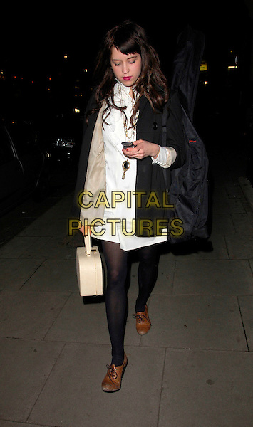 PEACHES GELDOF.At the Rodnik's Exhibition Private View at The Hospital Bar & Club, London, England, March 25th 2008..full length cream bag black coat jacket  white shirt dress tights brown shoes .CAP/CAN.©Can Nguyen/Capital Pictures