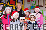Amy Griffin, Ciara Griffin, Rachel Quirke, Katie Keenan and Laura Corbert representing the children of Ballyfinnane NS presents the proceeds of the schools Christmas Concert raffle to Eileen Daly Chairperson of the Ballyfinnane Community Hall to help with the cost of relocating the defibulator to the village