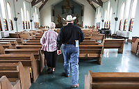 NWA Democrat-Gazette/DAVID GOTTSCHALK Sister Regina Schroeder (left), and Dennis Huggins, owner and auctioneer of Border Town Auctions, walk Thursday, May 9, 2019, walk through the chapel at the previous St. Scholastica Monastery in Fort Smith. The nuns of St. Scholastica Monastery moved in January from their very large almost century-old building into a smaller convent. They are selling hundreds of items at auction beginning Thursday.