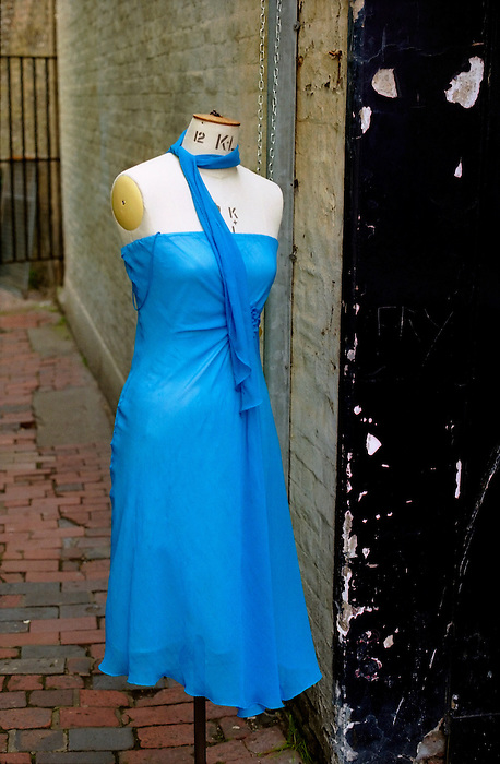 A mannequin in a blue dress in an alley in Brighton. England 2005.