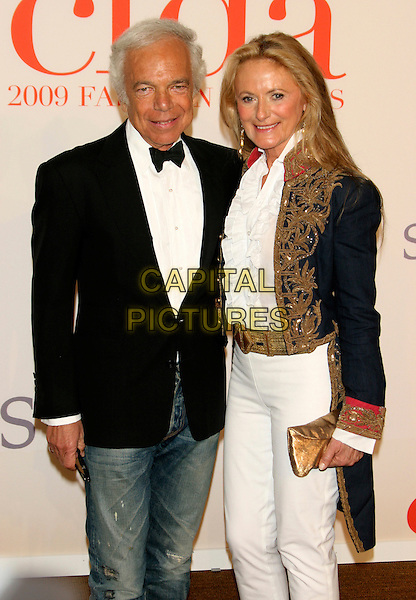 RALPH LAUREN & RICKY.2009 CFDA Fashion Awards at Lincoln Center's Alice Tully Hall, New York, NY, USA..June 15th, 2009.half length married husband wife black suit jacket bow tie white shirt 3/4 jeans denim top gold bronze embroidered clutch bag  .CAP/LNC/TOM.©TOM/LNC/Capital Pictures.