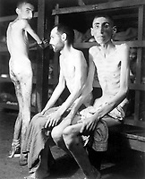 These Russian, Polish, and Dutch slave laborers interned at the Buchenwald concentration camp averaged 160 pounds each prior to entering camp 11 months ago.  Their average weight is now 70 pounds.  Germany, April 16, 1945.  Pvt. H. Miller. (Army)<br /> NARA FILE #:  111-SC-203648<br /> WAR & CONFLICT BOOK #:  1107