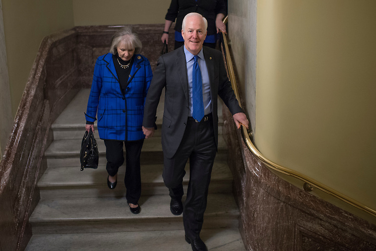 UNITED STATES - FEBRUARY 15: Senate Majority Whip John Cornyn, R-Texas, and his wife Sandy, make their way to the first floor of the Capitol, February 15, 2017. (Photo By Tom Williams/CQ Roll Call)