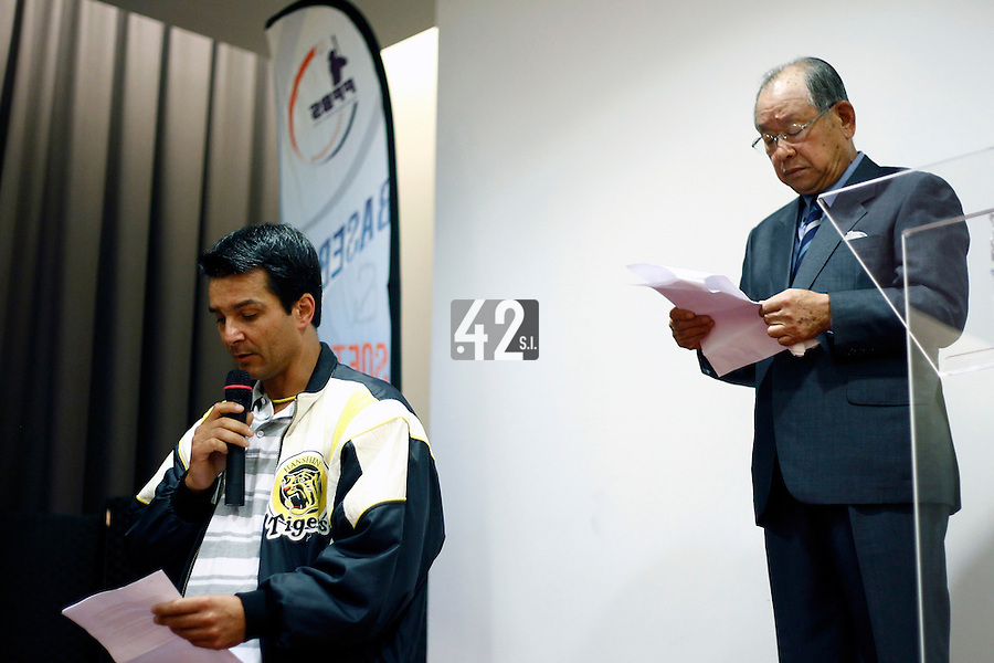 16 July 2011: David Jean Albert Meurant translastes as Japanese Hall of famer Yoshio Yoshida, of the Hanshin Tigers, and former France Team Manager is honored by the French Federation of Baseball during the 2011 Challenge de France in Rouen, France.