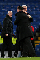West Brom Manager, Alan Pardew, embraces old friend, Martin Allen on the pitch pre-match as match referee, Lee Mason looks on during Chelsea vs West Bromwich Albion, Premier League Football at Stamford Bridge on 12th February 2018