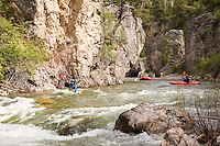 Boaters navigate Belt Creek deep in Sluice Boxes State Park near Belt, Montana.