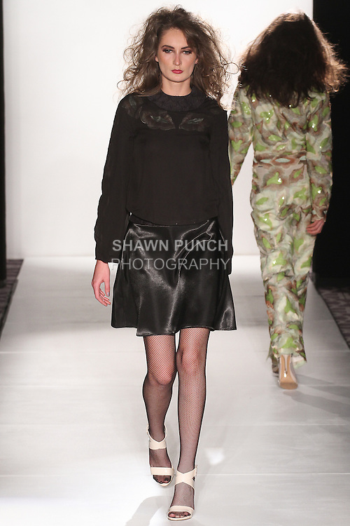 """Model walks runway in an outfit from the Bea Rodriguez """"Klimpted"""" Fall Winter 2015 collection, during the Pret-A-Porter Fall 2015 fashion show for  Fashion Gallery New York Fashion Week Fall 2015."""