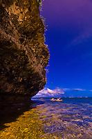 Sea kayaking by a grotto, Vatulele Island Resort, Fiji Islands