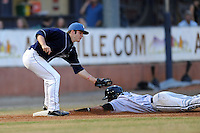 Asheville Tourists third baseman Matt Wessinger #16 applies the tag to a hard sliding Micah Johnson #37 during a game against the  Kannapolis Intimidators at McCormick Field on May 9, 2013 in Asheville, North Carolina. The Intimidators won the game 13-12. (Tony Farlow/Four Seam Images).