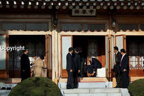 President Barack Obama puts his shoes back on after an official luncheon with South Korean President Lee Myung-bak at the Blue House in Seoul, South Korea, Nov. 19, 2009. (Official White House Photo by Pete Souza)<br /> <br /> This official White House photograph is being made available only for publication by news organizations and/or for personal use printing by the subject(s) of the photograph. The photograph may not be manipulated in any way and may not be used in commercial or political materials, advertisements, emails, products, promotions that in any way suggests approval or endorsement of the President, the First Family, or the White House. <br /> <br /> This official White House photograph is being made available only for publication by news organizations and/or for personal use printing by the subject(s) of the photograph. The photograph may not be manipulated in any way and may not be used in commercial or political materials, advertisements, emails, products, promotions that in any way suggests approval or endorsement of the President, the First Family, or the White House.