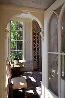 The framed doorway from the gothic conservatory opens into the tapestry drawing room