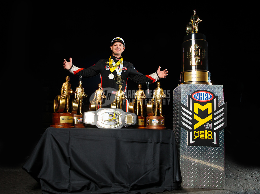 Nov 11, 2018; Pomona, CA, USA; NHRA top fuel driver Steve Torrence poses for a portrait as he celebrates after winning the Auto Club Finals at Auto Club Raceway. Torrence swept all six of the countdown to the championship races to clinch the world championship. Mandatory Credit: Mark J. Rebilas-USA TODAY Sports