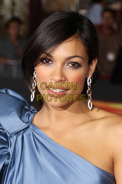 "ROSARIO DAWSON.Twentieth Century Fox world premiere of Tony Scott's action-thriller, ""Unstoppable,"" at the Regency Village Theater in Westwood. Los Angeles, CA, USA, October 26th, 2010. .portrait headshot silver earrings dangly  blue one shoulder silk satin  .CAP/CEL.©CelPh/Capital Pictures."