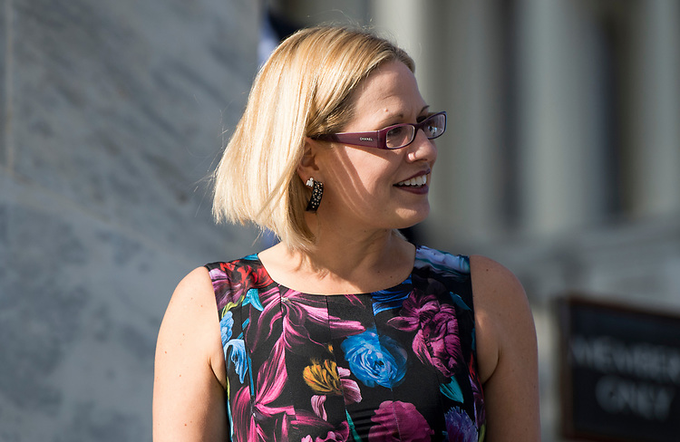 UNITED STATES - NOVEMBER 16: Rep. Kyrsten Sinema, D-Ariz., walks down the House steps at the Capitol following passage of tax reform on Thursday, Nov. 16, 2017. (Photo By Bill Clark/CQ Roll Call)