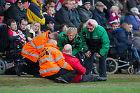 A Cheltenham is attended to by St John's Ambulance workers during the Sky Bet League 2 match between Cheltenham Town and Cambridge United at the LCI Stadium, Cheltenham, England on 18 March 2017. Photo by Mark  Hawkins / PRiME Media Images.