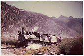 Fireman side view of RGS #74 bringing the 1951 Rocky Mountain Railroad Club Excursion into Telluride.<br /> RGS  Telluride, CO  Taken by Maxwell, John W. - 9/1951
