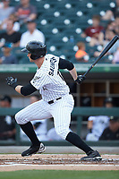 Michael Saunders (16) of the Charlotte Knights follows through on his swing against the Indianapolis Indians at BB&T BallPark on May 26, 2018 in Charlotte, North Carolina. The Indians defeated the Knights 6-2.  (Brian Westerholt/Four Seam Images)