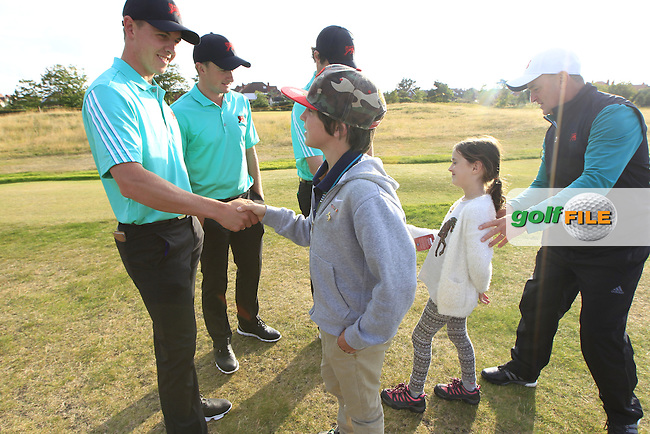 Grant Forrest (SCO), Paul Dunne (IRL), Cormac Sharvin (IRL) meeting children during the afternoon singles for the Walker cup Royal Lytham St Annes, Lytham St Annes, Lancashire, England. 13/09/2015<br /> Picture Golffile | Fran Caffrey<br /> <br /> <br /> All photo usage must carry mandatory copyright credit (&copy; Golffile | Fran Caffrey)