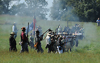 NWA Democrat-Gazette/ANDY SHUPE<br /> Rifles are fired Saturday, Sept. 26, 2015, by Confederate infantrymen in a volley down the hill toward the Union troops during a re-enactment of the Civil War Battle of Pea Ridge in Pea Ridge. Visit nwadg.com/photos to see more photos from the weekend.