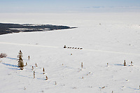 Aerial of Jeff King on top of Little Mckinley between Elim and Golovin during the 2010 Iditarod