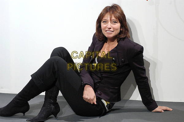 "SUSANNE BIER .Photocall for ""After The Wedding"" at the Rome Film Festival, Rome, Itlay..October 19th, 2006.Ref: CAV.full length black jacket trousers sitting.www.capitalpictures.com.sales@capitalpictures.com.©Luca Cavallari/Capital Pictures."