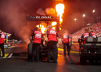 Aug 30, 2019; Clermont, IN, USA; Fire from pyrotechnics go off as crew members push the dragster of NHRA top fuel driver Doug Kalitta to the starting line during qualifying for the US Nationals at Lucas Oil Raceway. Mandatory Credit: Mark J. Rebilas-USA TODAY Sports