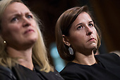 UNITED STATES - SEPTEMBER 27: Ashley Estes Kavanaugh listens to her husband, Judge Brett Kavanaugh, during the Senate Judiciary Committee hearing on his nomination be an associate justice of the Supreme Court of the United States, focusing on allegations of sexual assault by Kavanaugh against Christine Blasey Ford in the early 1980s. Laura Cox Kaplan appears at left. (Photo By Tom Williams/CQ Roll Call)