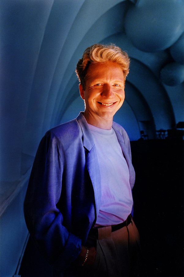 "In the Hollywood Bowl for the Los Angeles Times shot in the middle of a sunny day on Tungsten color balanced transparcy film which made the underexposed bowl do deep blue. Strobes corrected for the tungsten balance back to daylight lighted him. From Wikipedia:<br /> ""John Francis Mauceri is an American conductor, producer and arranger for theatre, opera and television. For fifteen years, he served on the faculty of Yale University. Wikipedia<br /> Born: September 12, 1945, New York.<br /> Spouse: Betty Mauceri<br /> Education: Yale University<br /> Movies: The Hollywood Sound: Music for the Movies<br /> Albums: Star Wars: The Sound of Hollywood, Hollywood Dreams, and more.<br /> Awards: Grammy Award for Best Opera Recording, Tony Award for Best Revival, Drama Desk Award for Outstanding Revival."
