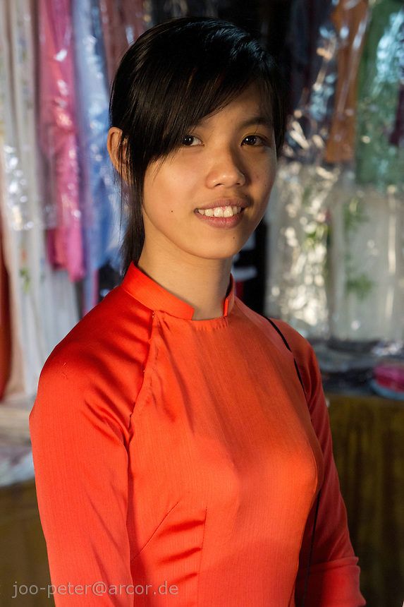 woman in traditional vietnamese costume called Aoi dai,  in the city Hoi An, Vietnam