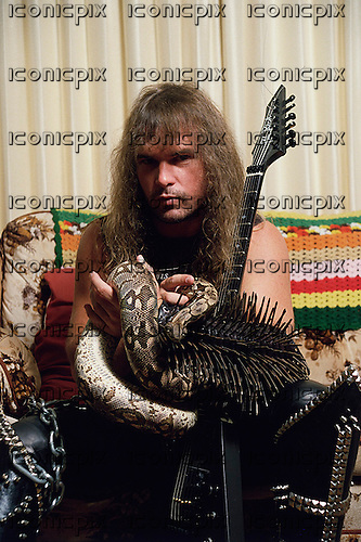 Slayer - guitarist Kerry King - exclusive photosession with his pet python in Los Angeles CA USA - 1987.   Photo credit: Alex Solca/IconicPix