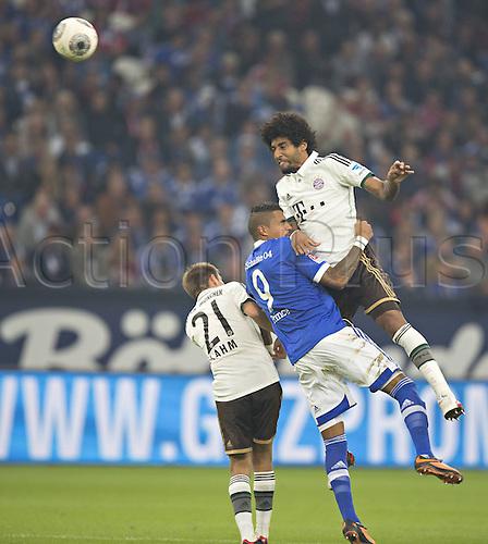 21.09.2013. Gelsenkirchen, Germany. Veltins Arena Football Philipp Lahm FCB Kevin Prince Boateng S04 Dante FCB FC Schalke 04 FC Bavaria Munich