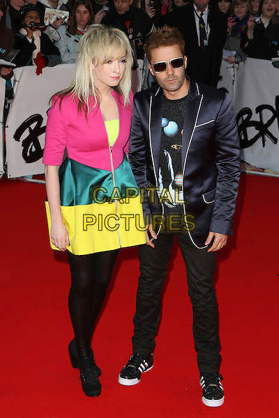 THE TING TINGS - KATIE WHITE & JULES DE MARTINO.Arrivals - 2009 Brit Awards, Earls Court, London, England, .February 18th 2009.brits full length pink yellow colour block dress jacket black tights booties shoes boots leggings adidas trainers blue blazer.CAP/MAR.© Martin Harris/Capital Pictures.