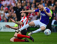 Lincoln City's Ollie Palmer vies for possession with Exeter City's Jake Taylor<br /> <br /> Photographer Andrew Vaughan/CameraSport<br /> <br /> The EFL Sky Bet League Two Play Off First Leg - Lincoln City v Exeter City - Saturday 12th May 2018 - Sincil Bank - Lincoln<br /> <br /> World Copyright &copy; 2018 CameraSport. All rights reserved. 43 Linden Ave. Countesthorpe. Leicester. England. LE8 5PG - Tel: +44 (0) 116 277 4147 - admin@camerasport.com - www.camerasport.com