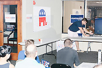 A staff member shows volunteers how to use the phonebanking system in the Palm Beach Republican Club and West Palm Beach Victory Headquarters office in West Palm Beach, Florida. The office serves as a place for volunteers to gather and organize for various Republican campaigns, including Donald Trump's general election campaign.