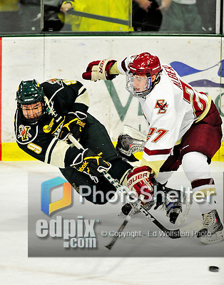 12 November 2010: University of Vermont Catamount forward Wahsontiio Stacey, a Senior from Kahnawake, Quebec, centers the puck while taking a dive during game action against the Boston College Eagles at Gutterson Fieldhouse in Burlington, Vermont. The Eagles edged out the Cats 3-2 in the first game of their weekend series. Mandatory Credit: Ed Wolfstein Photo
