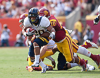September 22, 2012: California's Isi Sofele tries to stay up for more yardage during a game against USC at the Los Angeles Memorial Coliseum, Los Angeles, Ca  USC defeated California 27- 9