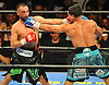 Danny Garcia, right, lands a blow to the face of Brooklyn native Paulie Malignaggi in the main event during a 12-round Premier Boxing Champions match at the Barclays Center on Saturday, August 1, 2015. Garcia won the bout by TKO in the ninth round. <br /> <br /> James Escher