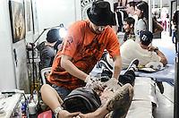 SÃO PAULO, 20.07.2013. Movimentação durante o Tattoo Week SP – 2013, encontro internacional de tatuadores e body piercers que reunirá grandes nomes da arte no corpo em São Paulo, Local: Expo Center Norte região norte da capital paulista, o evento termina amanhã dia 20. (Foto: Adriano Lima / Brazil Photo Press).