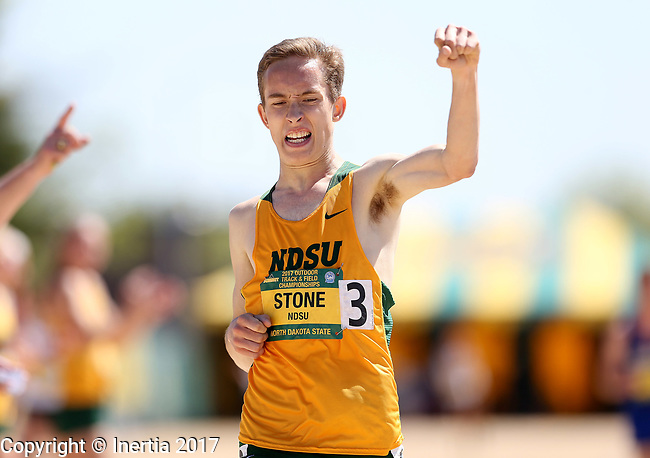 FARGO, ND - MAY 13: Elliott Stone from North Dakota State University celebrates winning the men's 5,000 meter run Saturday at the 2017 Summit League Outdoor Track Championship at the Ellig Sports Complex in Fargo, ND. (Photo by Dave Eggen/Inertia)